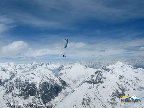 Paragliding amongst snow-capped giants. Photo: Himalayan Odyssey