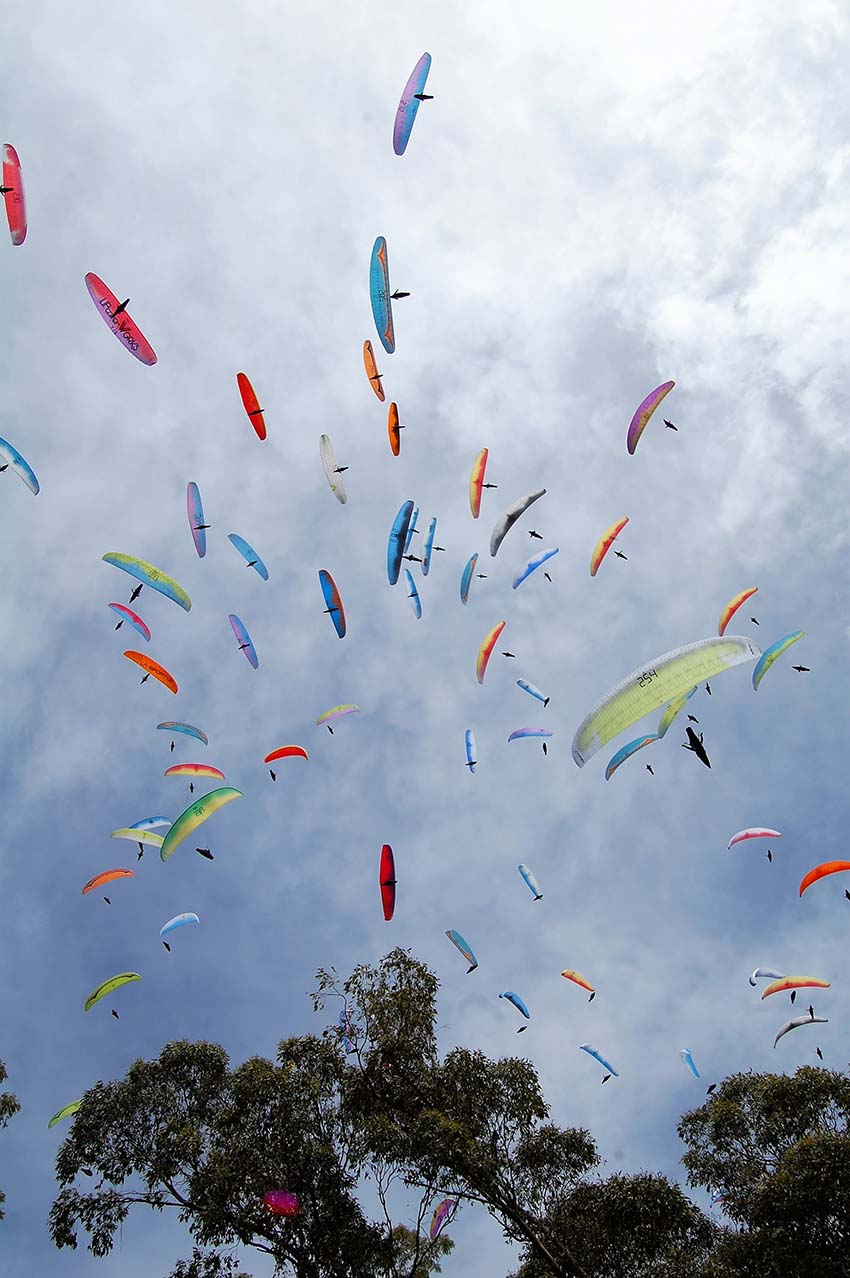 A crowded gaggle during the Paragliding World Cup in Australia, 2018