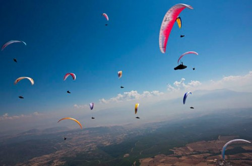Action from Task 1 at the Paragliding World Cup Superfinal. Photo: Martin Scheel
