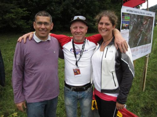 Bob Drury, centre, chats to Laura Turner, new British Paramotor Champion, and her driver and support crew, Michel Carnet