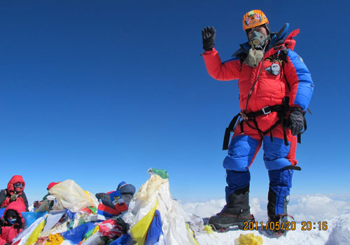Babu Sunuwar on the summit of Everest 21 May 2011, shortly before his flight from the summit. The date stamp is 12 hours early. Photo: Babu Sunuwar/Lakpa Tshering Sherpa
