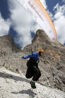 Michael Gerbert (GER) takes off at the foot of the Tre Cime during the Red Bull X-Alps, Italy on 21 July 2011. Photo: Red Bull X-Alps
