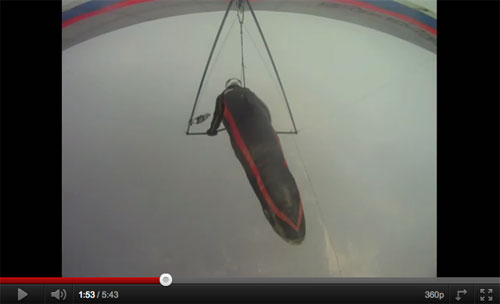 The hang glider pilot is sucked in –the ground is still just visible