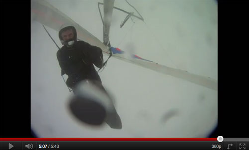Looking remarkably composed, and with his hang glider flipped upside down, the pilot descends under reserve