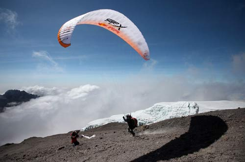 Andrew Smith launches from Kilimanjaro on Pierre's X-Alps paraglider