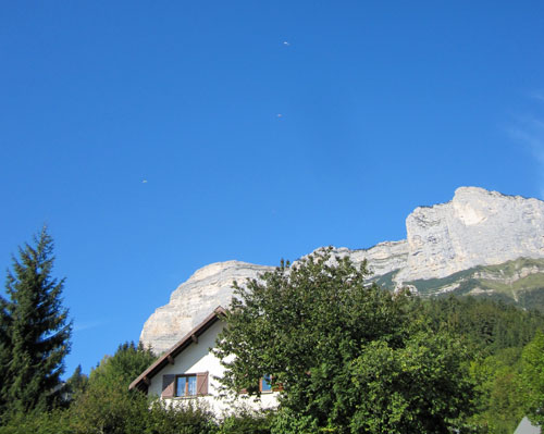 Blue skies... gliders fly down from the summit of the Chartreuse this morning. All photos: Ed Ewing