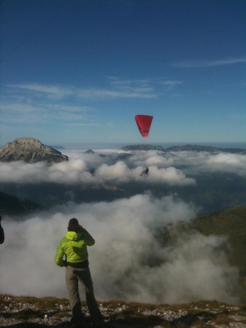 Russ Ogden flies Ozone's new single skinner above the clouds on the Dent de Crolles, 23 Sept 2011. Photo: Marcus King