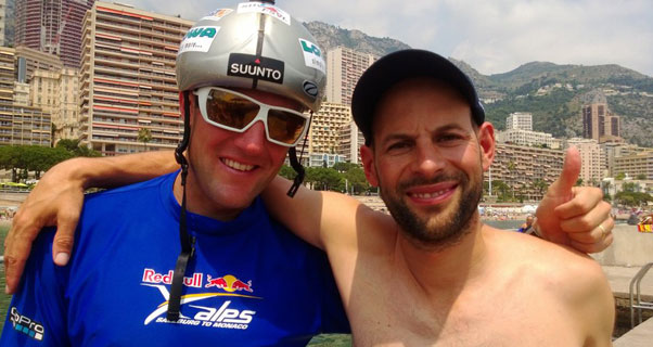 Chrigel Maurer and Thomas Theurillat on the raft in Monaco harbour after winning the Red Bull X-Alps 2013. Photo: Red Bull X-Alps / SUI1