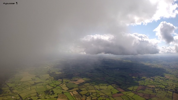 At base over England. Photo: FlyBubble Paragliding