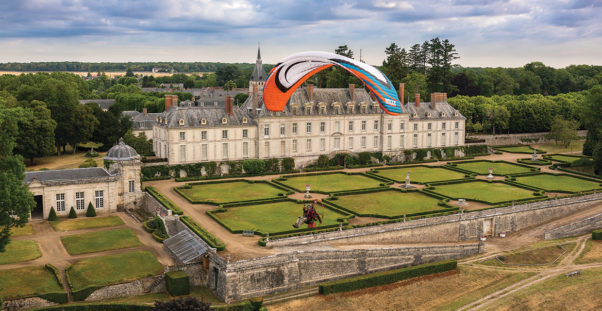 Luc Trepanier paramotoring in front of Chateau de Menars, France, Photo Jeff Hamann