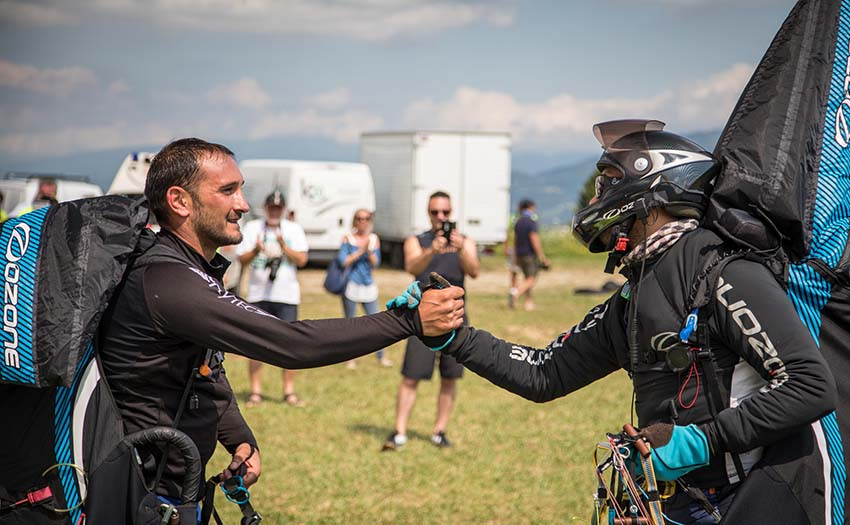 Two pilots congratulate each other at the FAI Paragliding World Championships in 2017. Photo: Marcus King