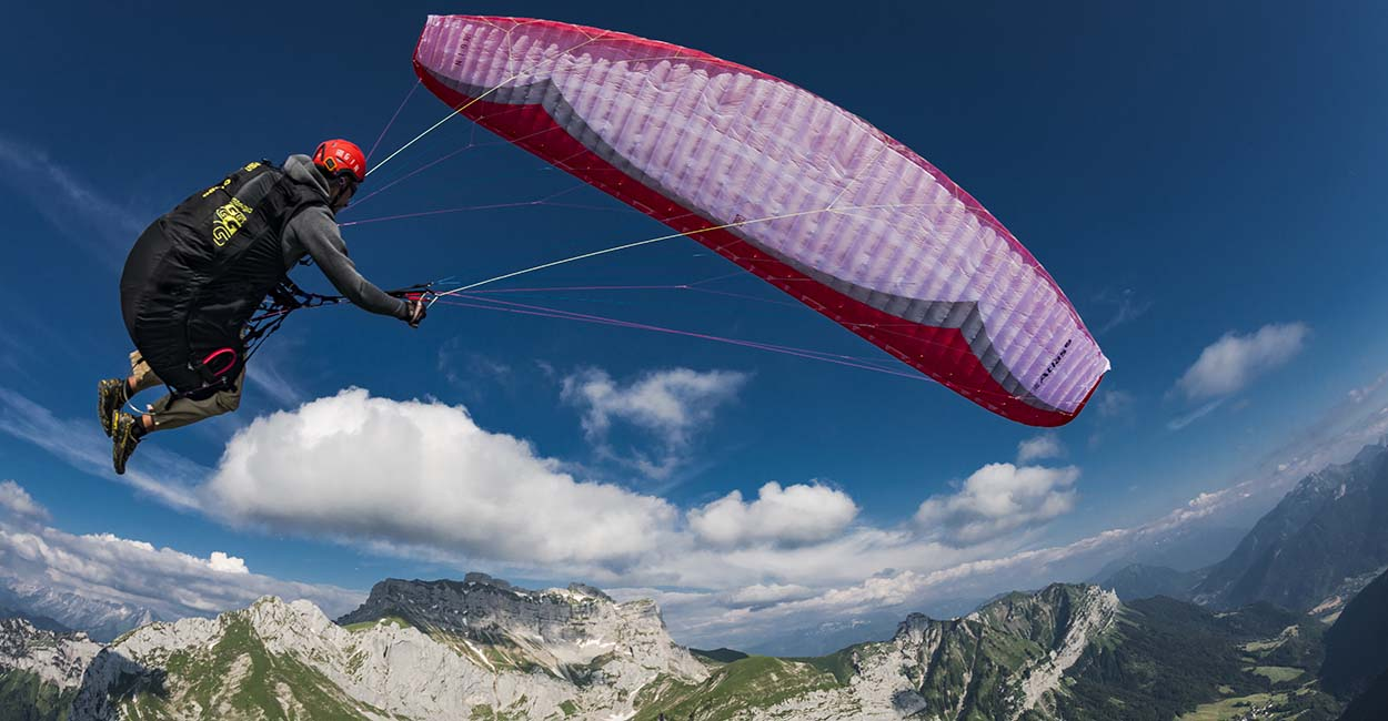 Jerome Maupoint on a paraglider doing a wingover in France