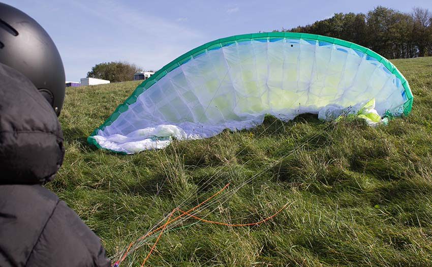 Managing a paraglider on the ground in wind