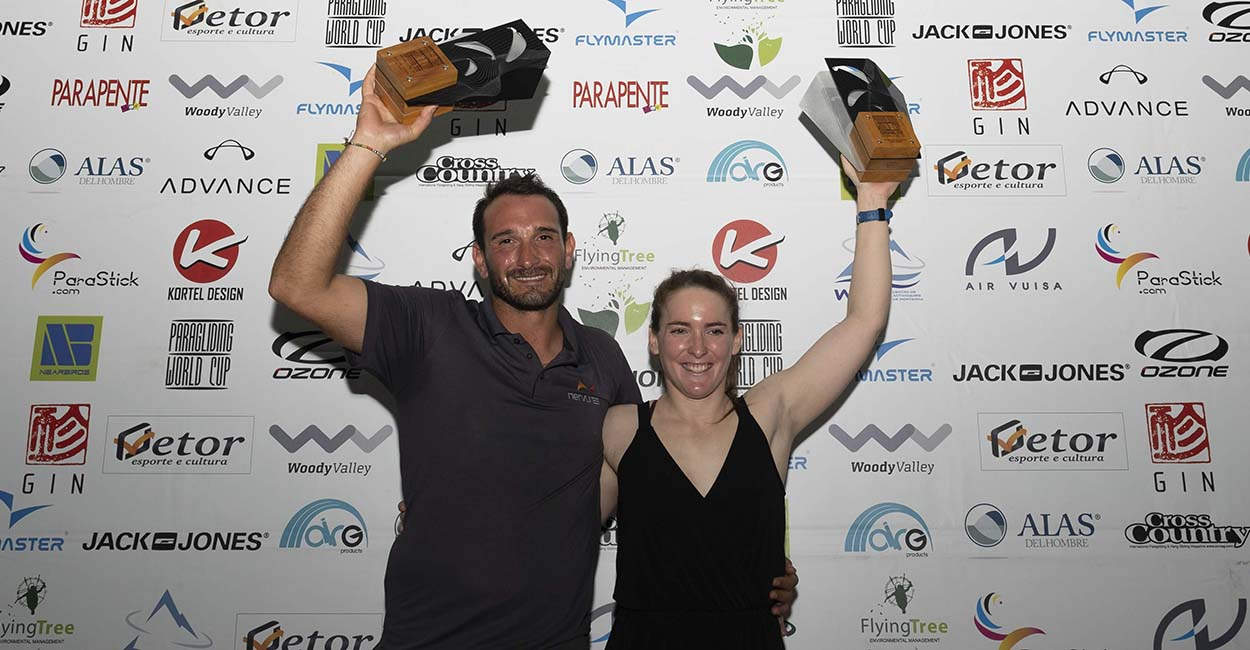 Pierre Remy and Meryl Delferriere celebrate their win at the Paragliding World Cup Super Final in Brazil