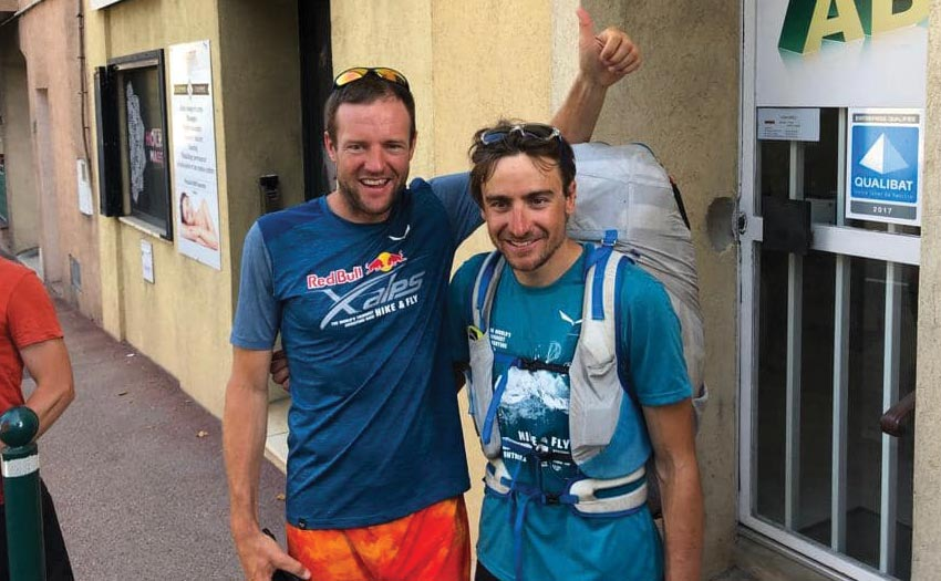 Chrigel greets Maxime Pinot as he finishes Red Bull X-Alps 2019