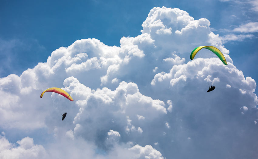 Building clouds and paragliders in Italy. Photo: Marcus King