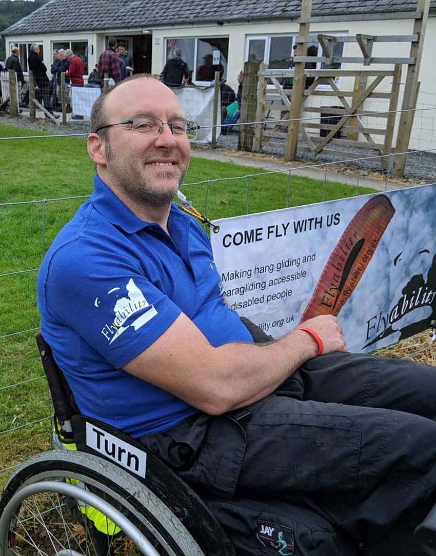 Handsome Ransome .. Flyability's George Ransome sports one of the charity's blue polo shirts. Photo: Flyability