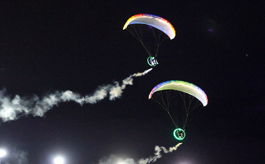 Tandem paramotor display flying at night. Photo: Ant Green