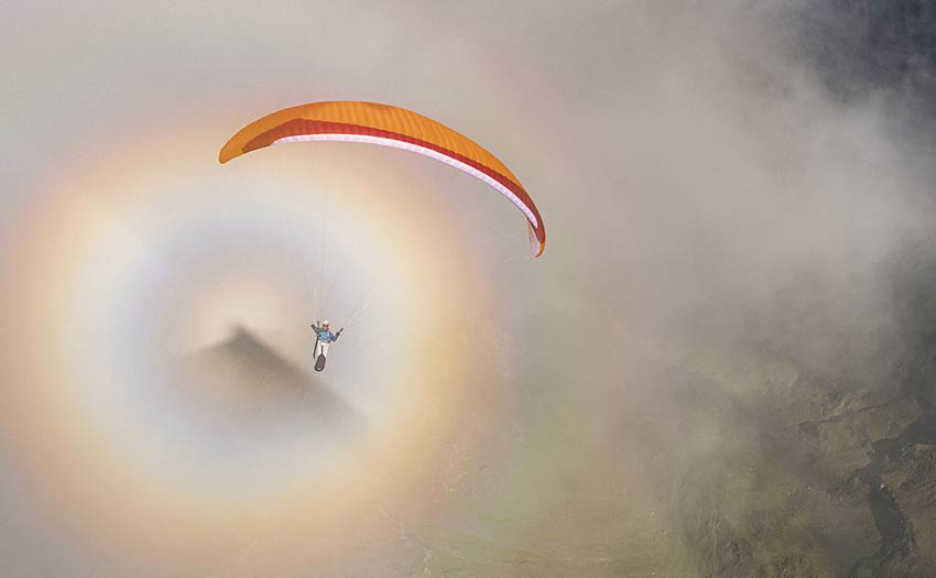 Marc Boyer paragliding in the Indian Himalaya with a brocken spectre. Photo: Jerome Maupoint