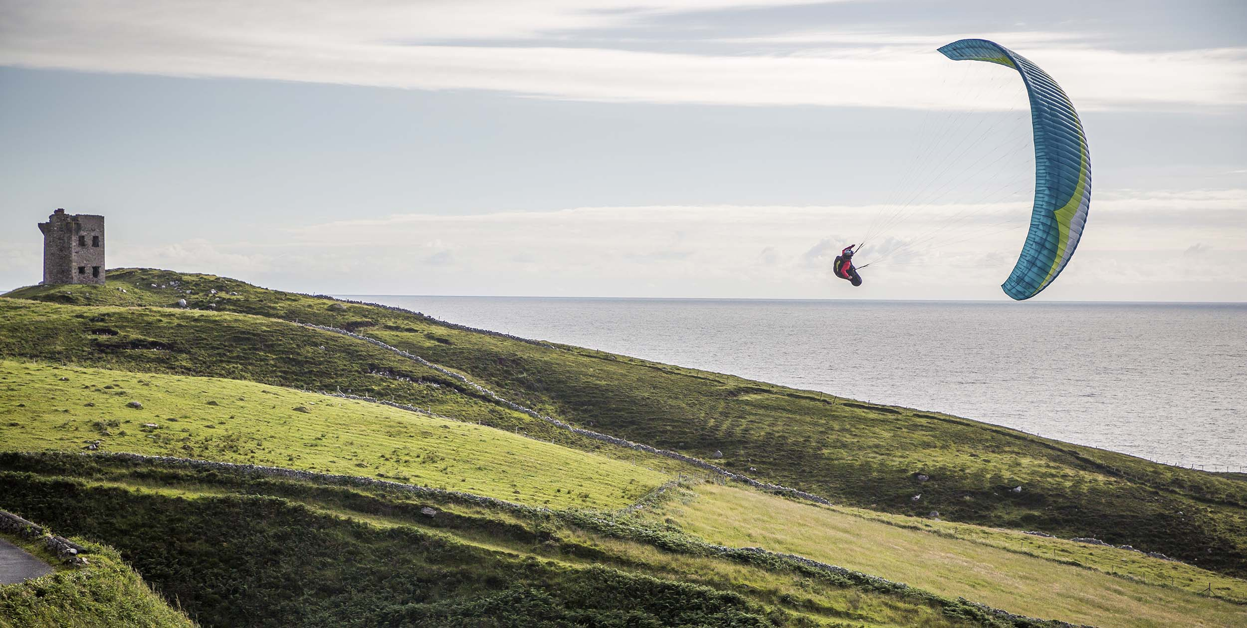 Will Gadd soaring a paragliding in Ireland. Photo: John Price / Red Bull Content Pool