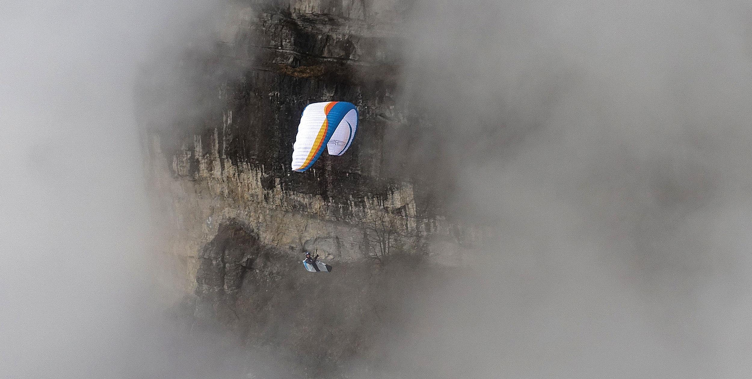 Paraglider in cloud
