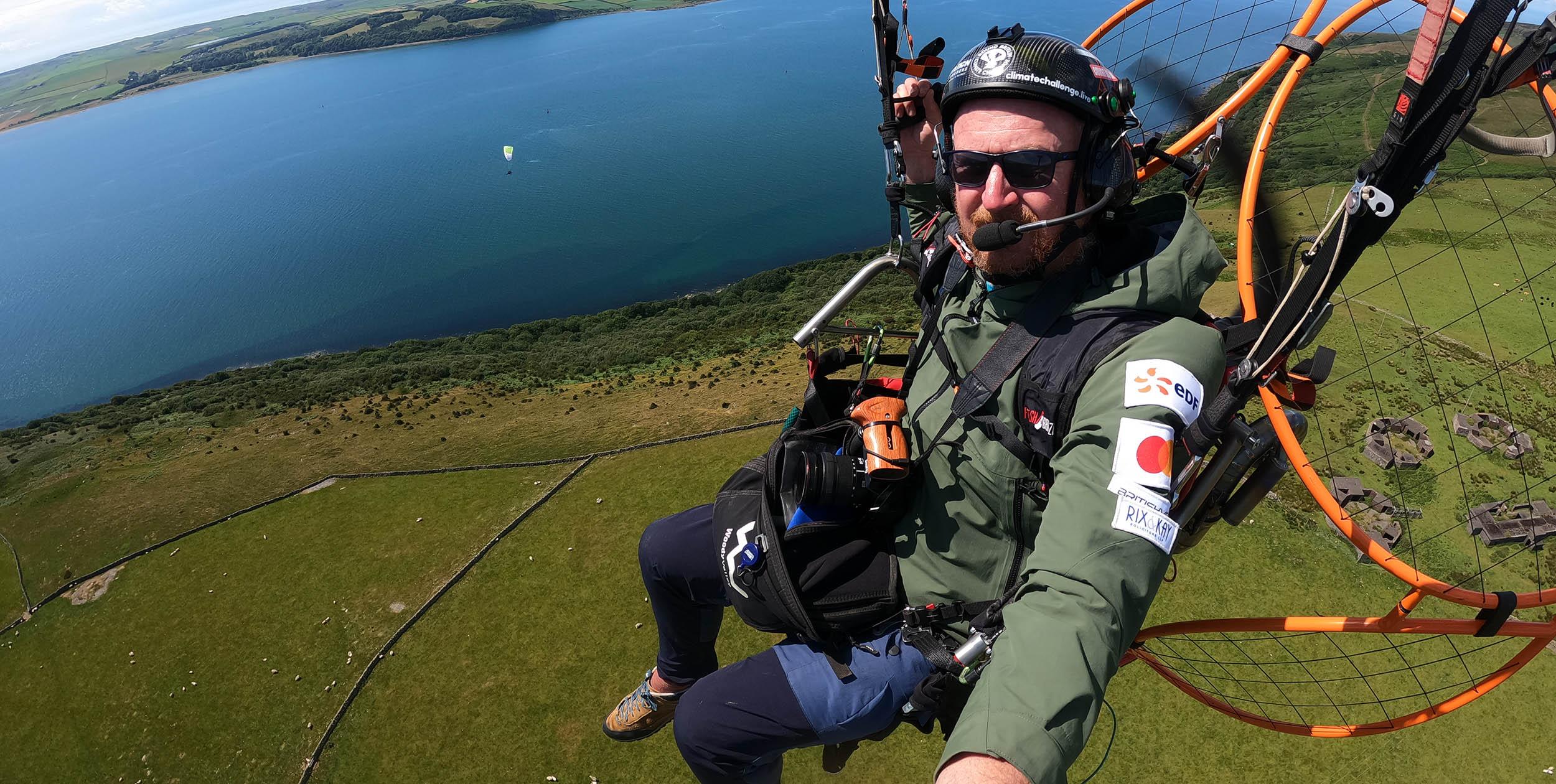 Dan Burton filming during the Round Britain Climate Challenge in July. Photo: Dan Burton