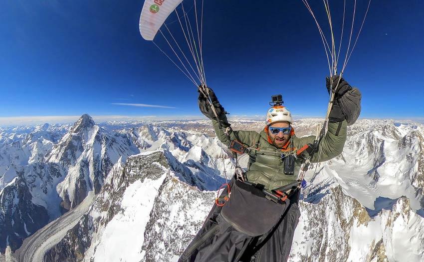 Antoine Girard paraglides above Broad Peak July 2021